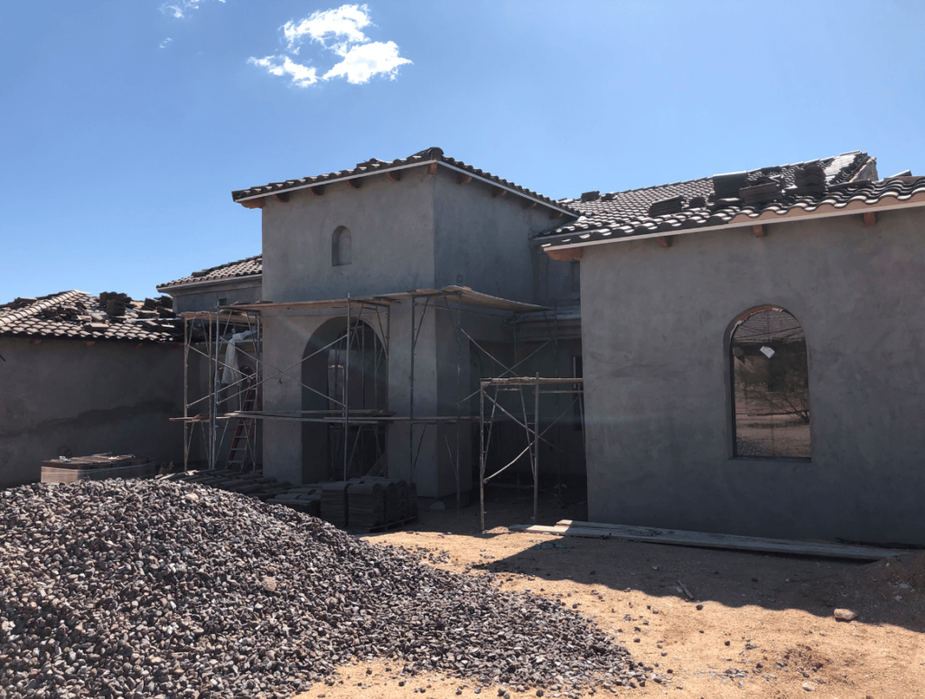 Cave Creek brown stucco bordeaux builders